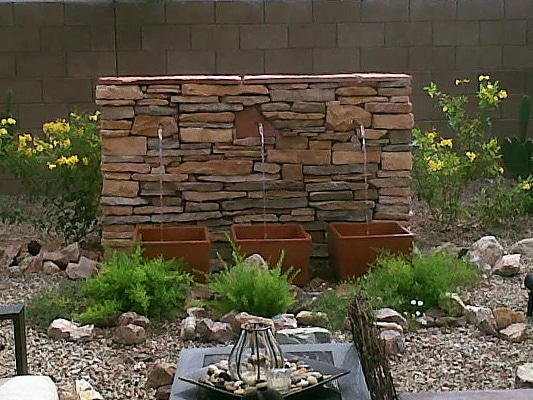 Gorgeous water feature surrounded by custom landscape design